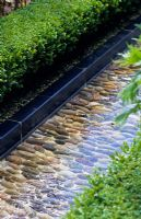 Pebble lined rill in the walled garden at Alnwick Castle