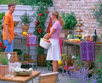 Man and woman talking at barbecue party