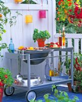 Portable barbecue on balcony garden