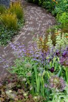 Path made of Clay pavers and planting of 