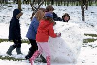 Children making a giant snowball