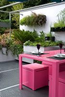 Pink metal table and chairs in rooftop garden - Living on the Ceiling 'No more room down there' Garden - Hampton Court Flower Show 2008