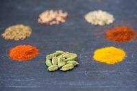 Piles of Indian spice on slate