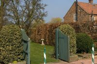 Open gateway leading to lawn in country garden - Hatch End, Yorkshire