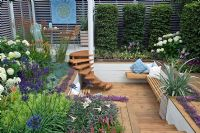 The Sadolin Four seasons Garden showing Sunken deck area with seating and Spiral staircase - RHS Hampton Court Palace Flower Show 2008 - Gold medal
