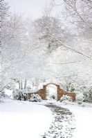 Brick arch and path in the snow at Honeybrook House Cottage, Worcestershire