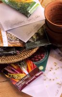 Selection of garden seed packets on potting bench