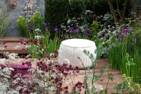 Naturalistic planting to attract a diverse range of insects surround a timber seating area, planting includes Acer campestre, Taxus baccata, Cirsium rivulare, Anthriscus sylvestris 'Ravenswing', Iris germanica, Euphorbia palustris, Digitalis, Deschampsia caespitosa and Aquilegia 'Ruby Port' - Nature Ascending Garden - Gold medal winner for Urban Garden at RHS Chelsea Flower Show 2009