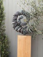 Spiral stone garden sculpture by Tom Stogdon at the RHS Chelsea Flower Show