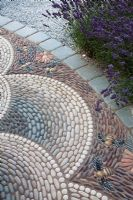 Detail of the decorative pebble paving in 'A Beekeeper's Garden' at RHS Hampton Court Flower Show 2009