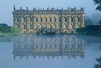 View across the Canal Pond to south facade of house - Chatsworth House, Derbyshire.