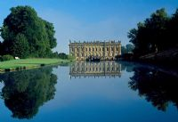 View across the Canal Pond to south facade of house - Chatsworth House, Derbyshire