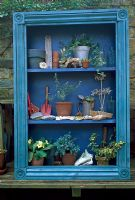 Blue painted theatre with small plants