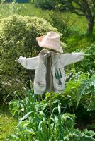 Vegetable patch with scarecrow