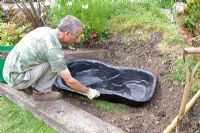 Garden pond project - step by step - whole in ground being prepared for the mould
