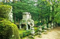 View to Elephant with River God in foreground - Bomarzo, Sacro Bosco. Also known as Parco dei monstri, Viterbo, Italy, a 16th century garden