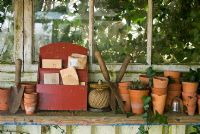 Clay pots and seeds in potting shed