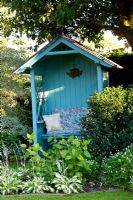Painted gazebo in country garden
