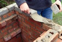 Building a barbeque. Step 10 of 11. Add the finishing layer of brick setts to creat a neat top edge