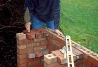Building a barbeque. Step 8 of 11. Continue building a further three courses of bricks. Add a further supporting layer of bricks for the grill