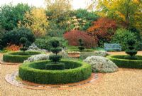 The courtyard with clipped Buxus - Box circles and Taxus - Yew topiary in autumn