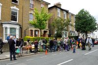 People at plant sale in an urban street, Hackney, London, UK