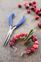 Making a Cranberry and Bay leaf decorative ring -  using pliers twist the two ends of the wire together
