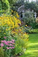 Autumn border of Helenium and Sedum