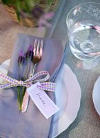 Table laid for entertaining with name tags