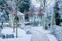 Formal town garden with gazebo covered in snow, Oxford, UK.