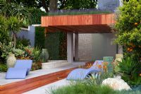 Pavilion with 'living roof' and purple loungers - 'A Monaco Garden' - Gold Medal Winner, RHS Chelsea Flower Show 2011