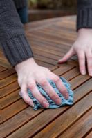 Wiping down, cleaning, patio table surface