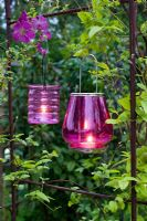 Hanging Pink tealight holders in evening garden