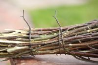 Making a Birch broom - birch branches tied together with steel wire.