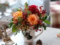 Floral display with Rosa, rosehips, Hedera and Ilex