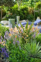 Mediterranean style planting -  Aloe trees, Rosemary, Citrus tree and Geum in  'A Monaco Garden', Gold medal winner, RHS Chelsea Flower Show 2011