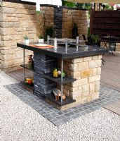 Outdoor kitchen on stone patio