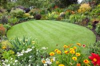 Circular lawn surrounded by flowerbeds