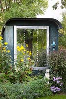 Mirror placed on trailer and used as a summerhouse