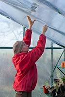 Insulating a greenhouse to protect young plants