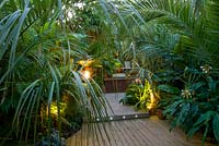 Decked terrace with exotic planting