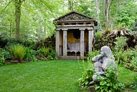 The Stumpery with one of the two temples and a statue 'Goddess of the Woods' - Highgrove Garden, May 2008.