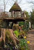 The thatch tree house 'Hollyrood House', The Stumpery, Highgrove Garden, March 2011. The Stumpery is based on a Victorian concept for growing ferns amongst tree stumps.