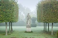 Hedges and statue. The statue is one of four goddesses representing the four seasons. These are from Italy.