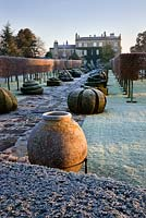 Yew topiary, the Thyme Walk and The House with frost, Highgrove Garden, December,2008.