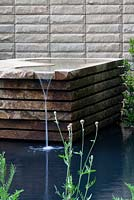 Yorkshire stone water feature with contemporary stone wall behind - Homebase Teenage Cancer Trust Garden, Gold Medal winner - RHS Chelsea Flower Show 2012
