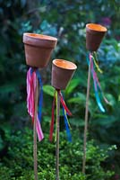 Garden tealight holders on bamboo canes