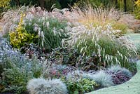 Autumn border with frost at Foggy Bottom, The Bressingham Gardens, Norfolk, UK