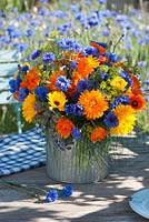 Bouquet of cornflowers and marigolds