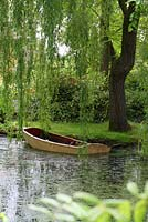 Old wooden rowing boat in the pond shaded by a weeping willow tree - Sallowfield Cottage B&B, Norfolk